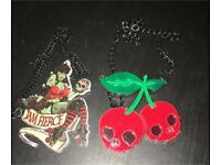 Roller Derby and Cherry Skull necklaces