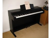 PIANO. Roland HP-147Re Digital Piano with matching adjustable seat.
