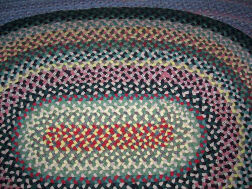 Antique Handmade Oval Wool Braided Rug in Good Condition 4