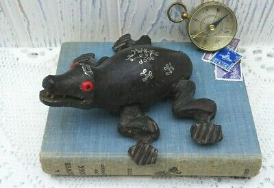 Antique wooden carving of a crocodile, silver wire inlay decoration, bead eyes