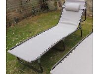 Sun lounger. 1 Brand new multi position including lie flat.