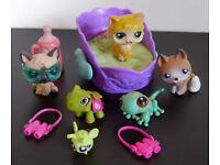 Littlest Pet Shop animals: gecko, sitting German Shepherd, bandaged Husky, Magic Motion cat & bed