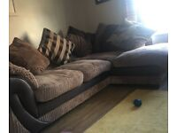 Fabric corner sofa & armchair with scatter cushions.
