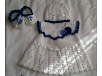 Handmade crochet dress with matching shoes and hat. Proffessionally made.
