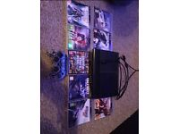 PS3 12gb black console, with 8 games