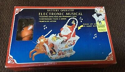 - Battery Operated Electronic Musical Christmas Santa And Rudolf Yuletide Concepts
