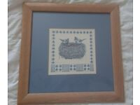 Two vintage art prints in glass with wooden frames.