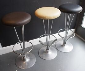 A trio of leather covered Piet Hein Barstools for Fritz Hansen
