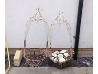 2 QUITE BIG ORNATE HANGING BASKETS OR HAVE FEET TO BE STANDING IN NEED OF SPRAY PAINTING!
