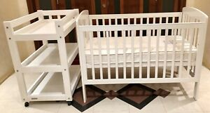 Near new white cot, mattress and changing table set
