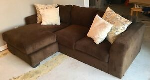 BROWN COUCH W/PILLOWS.