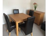 Oak Morris dining table, sideboard and nest of tables for sale.
