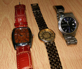Three Wrist Watches