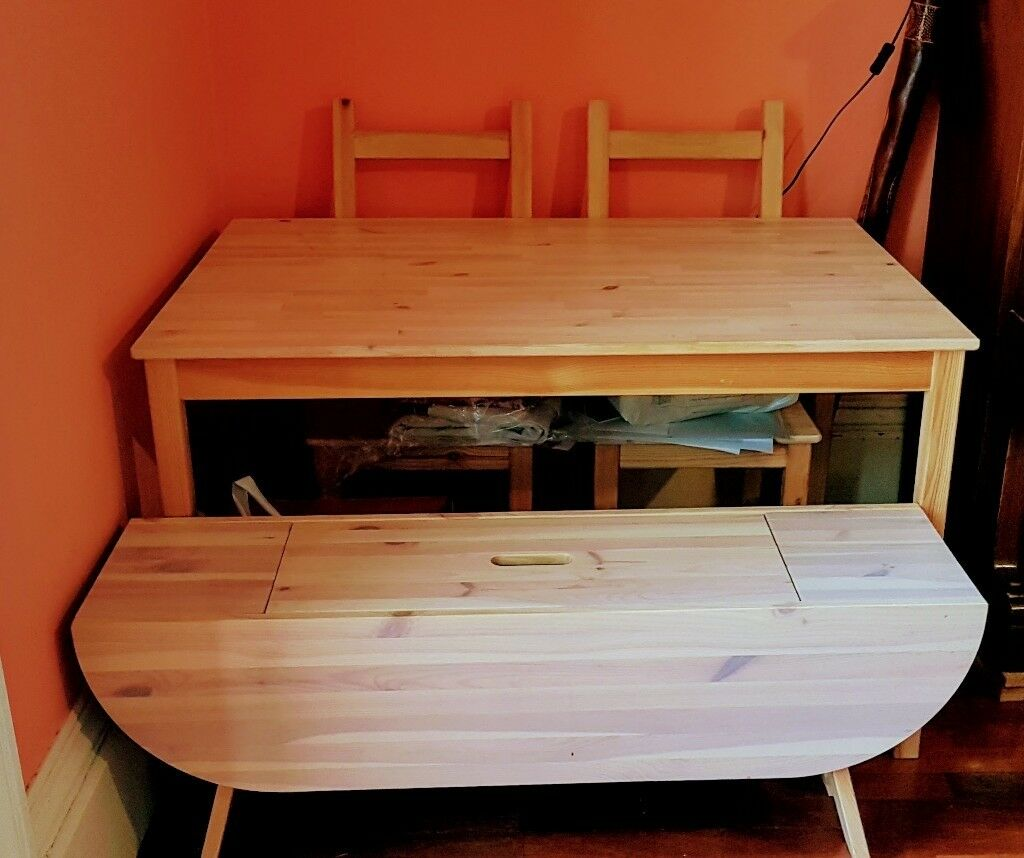 Dining table with 2 chairs and a bench with storage