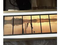 Sunken pier and lake at sunset print in solid gold coloured frame