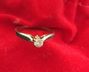 1/5 of a diamond solitaire engagement 14 k gold ring