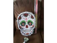 Halloween Day of the Dead pinata with stick and bag of skeletons