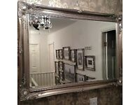 Large antique look silver mirror.