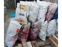 bags of firewood in the 25kg = 4 stone sized coal bags , pallet board cut offs