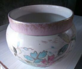 Large round pottery plant pot holder