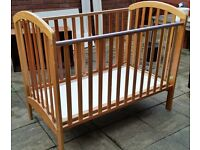 wooden cot. (mattress size 132cm x 70cm). adjustable base levels. drop side. In good condition.