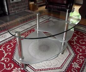 Oval glass and chrome coffee table