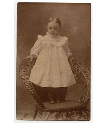 TODDLER/BABY GIRL IN WICKER CHAIR PHOTO POSTCARD