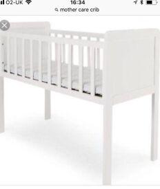 White mother care crib
