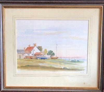 WATERCOLOUR OF A COTTAGE BY THE SEE SIGNED M.W.R.