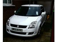 White suziki swift 2009 with Full mot