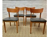 4 Mid Century Dining Chairs With Black Vinyl Seats