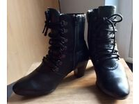 Size6 black leather granny boots. 2 inch heels, E fit, side zip closures and in mint condition.