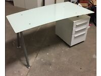 Smart white set of office furniture including glass top desks and storage cupboards