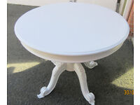 White painted gorgeous round table with ornate base, really substantial!