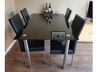 Black Glass Dining Table and Six Chairs