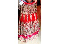 Red and pink wedding lengha