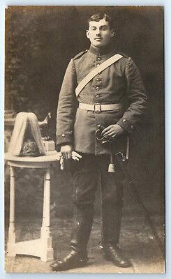 Antique WW1 GERMAN Real Photo RPPC Postcard SOLDIER Pickelhaube Helmet & SWORD