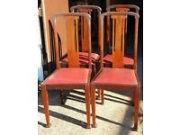 Set Of Four Walnut Dining Chairs With Drop-In Seat Pads