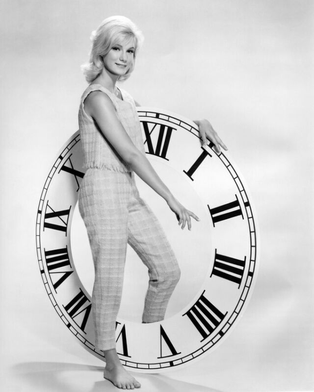 Yvette Mimieux Barefoot By Large Clock 8x10 Photo