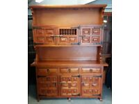 Chunky Pine Spanish Style Kitchen Dresser With Cup Hooks, Drawers, And Cabinets