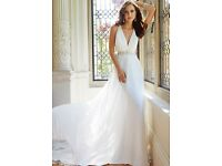 Brand new wedding dress size14L. Beautifully made with stunning beaded back and long train