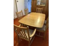 Ercol mid-century modern Windsor extending dining table with 6 chairs