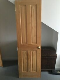 Interior softwood pine door, unpainted, with brass knob & 2 hinges. 610mmW x 2000mmH