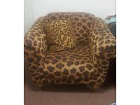 2 piece luxury leopard print luxury chair and footstool in very good condition.
