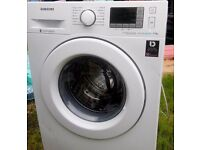 Brand new washing machine with little dents and few scratches SAMSUNG 9KG