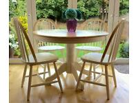 Round wooden table and 4 chairs.