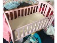 Pink swinging crib new condition never been used