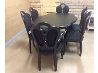 Stunning French style dining set,2 carver chairs 4 French style chairs and matching table.