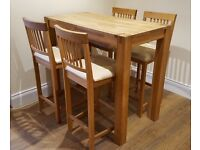 Solid Oak high breakfast table and 4 chairs form Glasswells