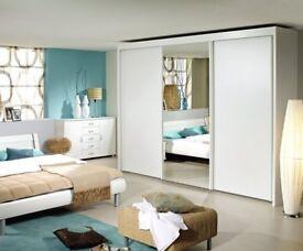 Imperial 3 door alpine white sliding door wardrobe . Mirrored centre door.